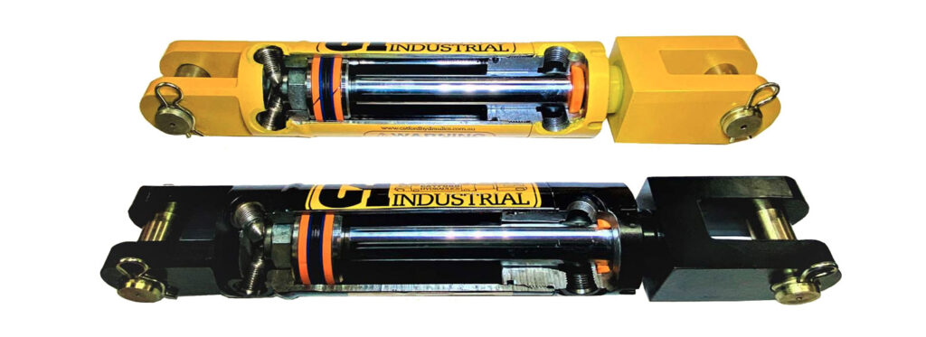 2 clevis end hydraulic cylinders in yellow and black colours